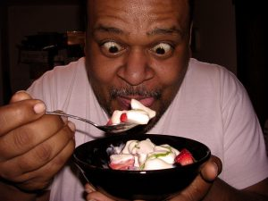 Man eating strawberries and cream