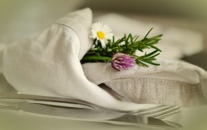 cloth napkin with flowers and cutlery