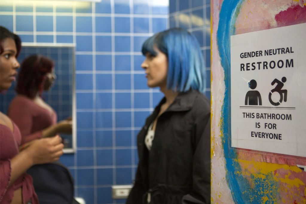Two students in a gender neutral bathroom