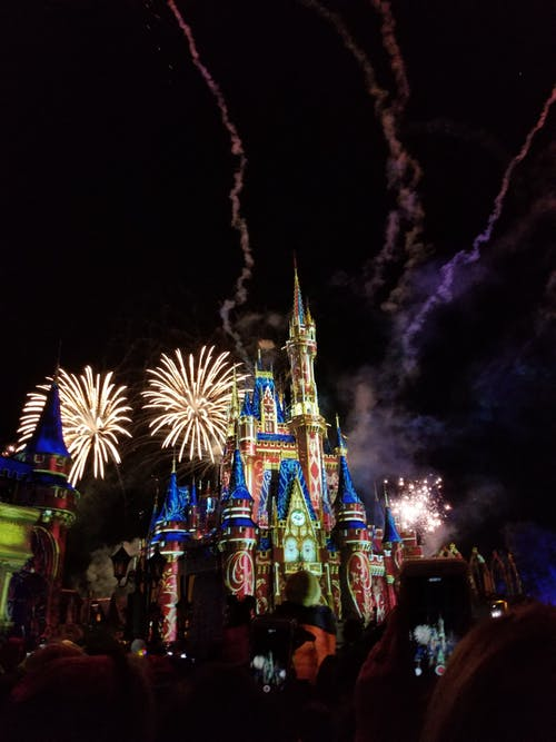 Fireworks exploding over disney castle