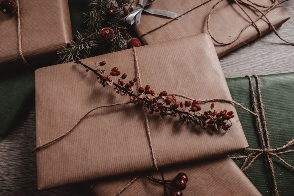 christmas present wrapped in brown paper and string