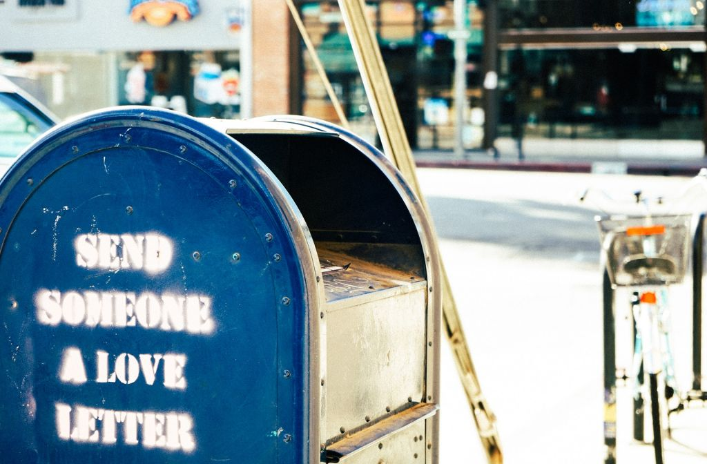 Post box with the text: Go send someone a love letter